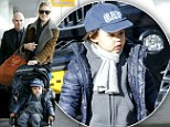 There's no place like home! Doutzen Kroes arrives at the airport in her native Netherlands with her cute son by her side
