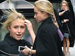 Hair-raising! Hayden Panettiere's new purple tipped locks take on a life of their own as she steps out in blustery New York