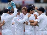 Got him: Stuart Broad celebrates taking the wicket of Hamish Rutherford in the evening session