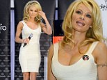 No one is looking at your nails! Pamela Anderson steps out in tight ivory bandeau dress to launch polish