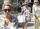 As long as mom approves! Ashley Tisdale flaunts her toned legs in tiny shorts during mother daughter shopping spree