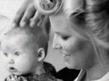 Mother and daughter: The fashion mogul's baby daughter captures the attention of the crew of the television show Fashion Star