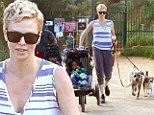 The single mother workout! Charlize Theron has her hands full as she walks pups and pushes baby Jackson while out on hike
