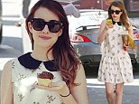 That's rare treat! Skinny Emma Roberts poses with a cupcake in a pretty vintage frock