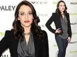 All covered up! Curvaceous Kat Dennings opts to hide her cleavage for a change in ruched top and blazer