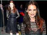 Isn't that uncomfortable? Katie Holmes gives a strained smile in stiff netted black dress at star-studded party