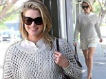 Feeling all white! Heroes star Ali Larter looks stunning in skimpy shorts as she goes walkabout in Los Angeles