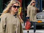 Out and about: Sienna Miller walks through New York