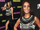 She sure is fly! Vanessa Hudgens puts on a leggy display as graces the Spring Breakers premiere in bejeweled feathered gown