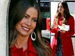 Lady in red: Sofia Vergara keeps things fiery while on the Modern Family set