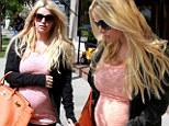 She's really blossoming! Jessica Simpson cradles her huge baby bump as she shops for her unborn son