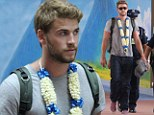 Bury himself in work: Liam Hemsworth now heads to the Philippines for promotional tour... as he continues to stay silent on split with Miley Cyrus