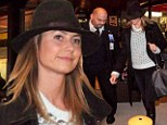 What break-up? Stacy Keibler touches down in Berlin to visit George Clooney following split rumours
