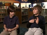 Heros: Rocky Hurt, 9, and Ethan Wilson, 10, were playing football outside their Georgia home on Monday when they heard Susanna Rohm's desperate cries for help
