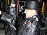 Under wraps! Madonna overdoes it with the layers as she steps out in rag tag outfit of scarves and leather hat