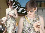 Blooming lovely! Anne Hathaway is pretty as a picture in a floral maxi dress as she makes a coffee stop with her husband