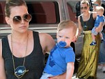 Shine on! Hilary Duff gleams in a metallic skirt as Baby Luca is decked out in blue and propped on her hip