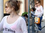 Ooh la la: Jennifer Lopez unleashes her wild side as she displays bright pink bra in 'Je t'aime' emblazoned shirt