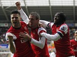 Party time: Arsenal celebrate after Nacho Monreal's scored the opening goal against Swansea