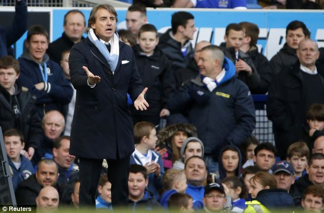 Furious: Manchester City boss Roberto Mancini was furious that Lee Probert didn't give his team a penalty for handball