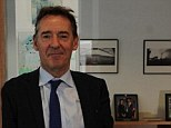 Power Player: Jim O¿Neill keeps footballs under the desk in his office