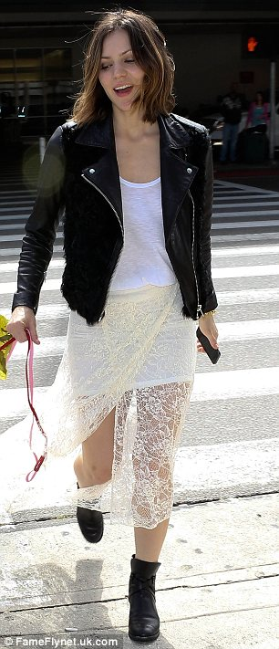 Spring twist: The singer and actress wore a sheer lace maxi skirt over a white vest dress adding a black leather biker jacket and boots to finish off her look