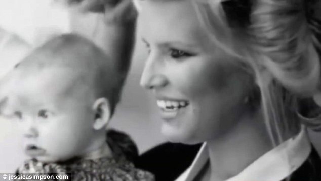 Proud parent: Jessica can be seen gushing over nine months old Maxwell in a behind-the-scenes Fashion Star video