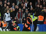 Unsavoury: A hot dog (right of shot) was hurled from the West Ham fans at Chelsea captain John Terry as he warmed up near the corner flag