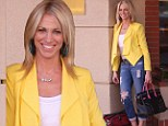 Still got it! Eighties favourite Debbie Gibson, 42, holds on to her Electric Youth in torn jeans and bright yellow jacket