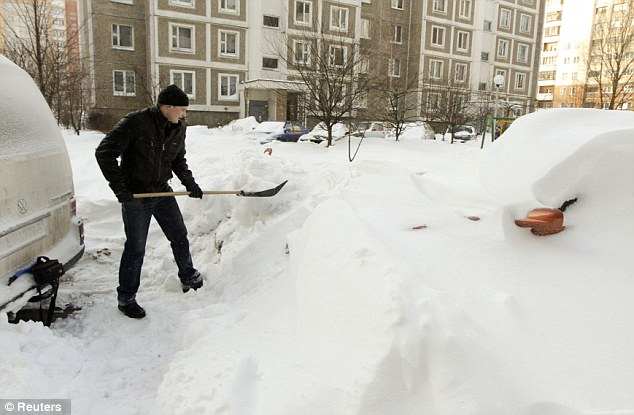 I know I left it round here somewhere: A man searches for his car which has been buried by snow in the Belarusian capital MInsk
