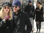Bradley Cooper and rumored girlfriend Suki Waterhouse enjoy the sites of Boston Common, Massachusettes while walking in freezing temperatures