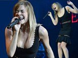 Pouring her heart out: LeAnn Rimes left in tears by standing ovation after putting on an emotional performance at 02 arena