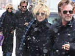 Let it snow! Meg Ryan and beau John Mellencamp cuddle up during a wintry day of shopping
