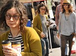 Style twins! Sara Gilbert and girlfriend Linda Perry step out with identical hairdos and equally scruffy clothes on family day out