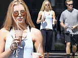 His and her workout! Ireland Baldwin ferries two smoothies as she hits the gym with boyfriend Slater Trout
