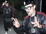Nod: David Arquette donned a Run DMC leather tracksuit in Hollywood, on Saturday