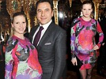 She really IS blooming: Lara Stone showcases her bump in rose-print dress as she joins David Walliams at party