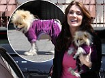 Dancing With the Stars contestant Lisa Vanderpump was put in the shade by her beloved dog Giggy as they arrived at the final rehearsal for the show.