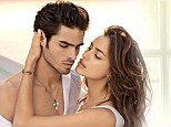 Come closer: Russian model Irina Shayk gets a little close to a male model as she takes part in a glossy photoshoot