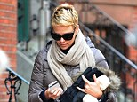 Juggling act: Charlize Theron showed off her wintry style while combating the 30-degree temperatures as she strolled through Boston with a male companion Monday