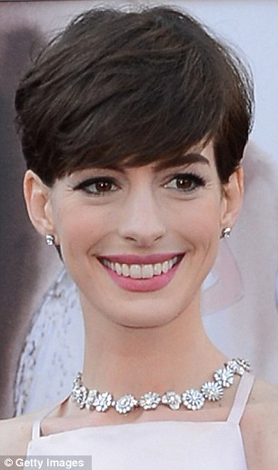 A Dark Knight for Anne: Hathaway will be disappointed at earning less after starring in two box office smashes while Brad Pitt was also outshone