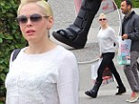 In the wars again: Rose McGowan was seen sporting a new foot cast in Los Angels, on Monday