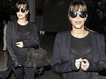 Over exposure! Kim Kardashian accidentally flashes her black bra after her top turns see-through under camera lights