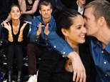 Can't get closer than this! A beaming Olivia Munn gets hugs and kisses from boyfriend Joel Kinnaman at Lakers game