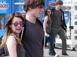 Emma Roberts and boyfriend Evan Peters can't keep their hands off each other as they enjoy a touchy feely stroll