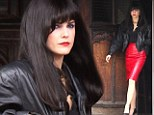 Who's the vamp? Keri Russell goes undercover in long black wig and red skirt for The Americans