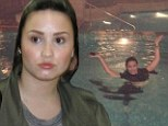 Demi Lovato tweets picture of her enjoying a swim in full make-up... but proves the barely there look works just as well for her