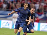 Targeted: France striker Karim Benzema has been the subject of calls by the National Front to exclude him for not singing the national anthem