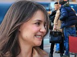 Time for a touch up? Katie Holmes shows off her greying hair as she has a flirty lunch in New York