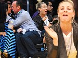 Floor violation! Kaley Cuoco tries to resist calling timeout on the touchy-feely couple next to her at the Lakers game